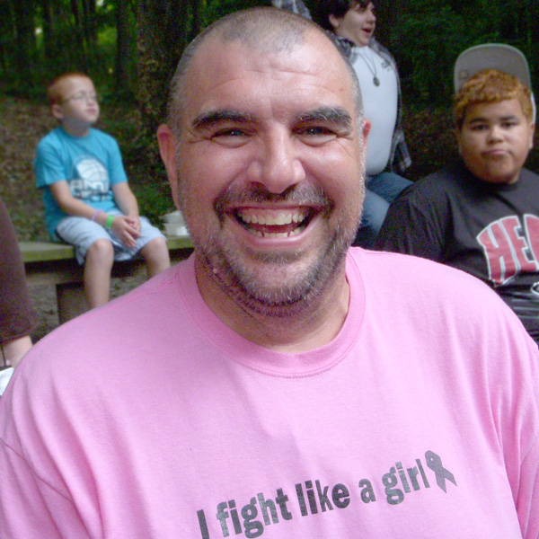 Volunteer Counselor at Camp Can Do wearing Fight Like a Girl tee shirt